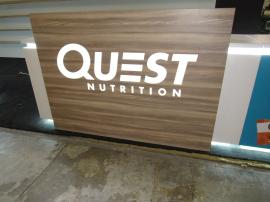 Custom Island Exhibit with Custom Counters, LED Perimeter Lighting and Logos, Locking Storage, Product Shelves, and Reception Counter